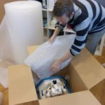 Daniel packs an MD100 for delivery to Australia.